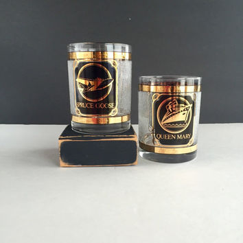 Rare 80's Queen Mary and Spruce Goose 22K Gold Lowball Glasses, Vintage Black and Gold Queen Mary and Spruce Goose Glasses Set of 2