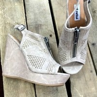 wedge sandals with peep toe and zipper in the front.