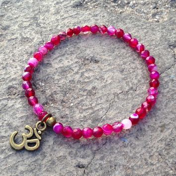 Grounding, Fine Faceted Pink Agate with Om Charm