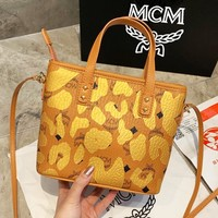 MCM sells women's brown camouflage graffiti embossed small shoulder bags