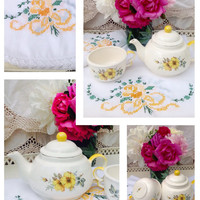 Adorable vintage teapot and cup with yellow roses and vintage embroidered rose table runners!