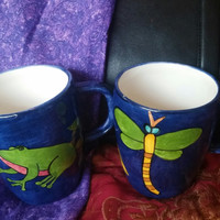 An Adorable Set of Two Laurie Gates Blue Mugs -  Frog and Dragonfly