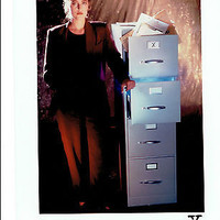 The X Files Dana Scully Next to Filing Cabinet Licensed Photo Gillian Anderson