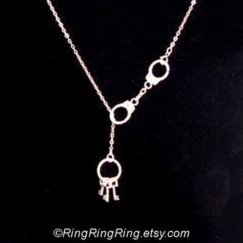 cute tiny keys and matching Handcuffs necklace on by RingRingRing