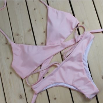 Fashion pure pink chest straps cross back knot bottom side open two piece bikini