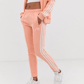 adidas Originals adicolor three stripe cigarette pant in pink | ASOS