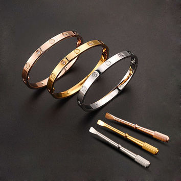 Stainless Steel Cartier Style locking bracelet with key
