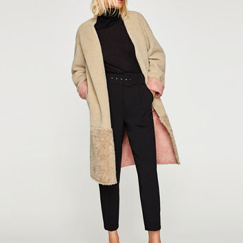 COAT WITH DOUBLE-SIDED EFFECT