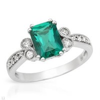 White Gold 1.42 CTW Emerald and 0.19 CTW Sapphire Ladies Ring. Ring Size 6.5. Total Item weight 3.3 g.: Jewelry