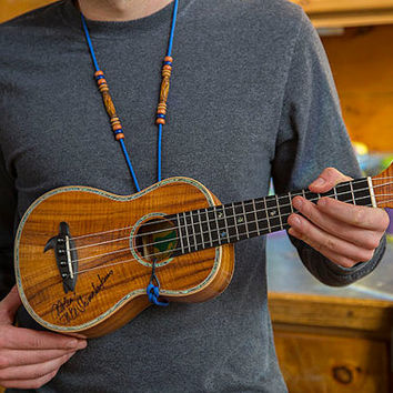 Handmade beaded adjustable ukulele strap that hooks in to the sound board