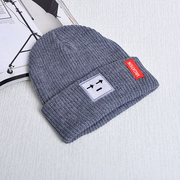 18b13b806193b9 Patch Smiley Face Arrow Eyes Beanie Knitted Womens & Mens Vacati