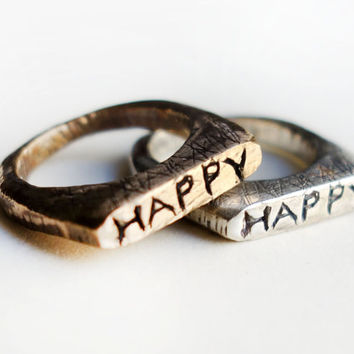 Handcarved Happy Rings in Bronze and Sterling Silver