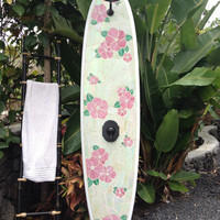 Outdoor surfboard shower with Hawaiian floral design. Stained glass mosaic design on an 8' longboard