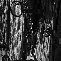 Old And Abandoned Wooden Door With Skeleton Keys by Angelo DeVal
