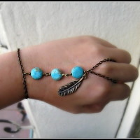 tribal feather and turquoise slave bracelet <3