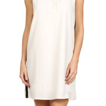 This chic sleeveless shift dress features a classic collared neckline, sleeveless, textured fabrication with black collared design, hidden button up front, horizontal texture knit, and contrasting black piping along sides. Fully lined.