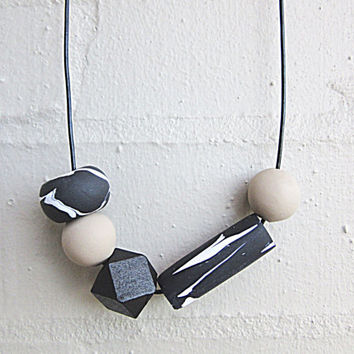 NL-220 Black and White Pattern Multi-shaped and Rhino Grey Round Beads with Black Faceted Wooden Bead Necklace in Adjustable Leather Cord