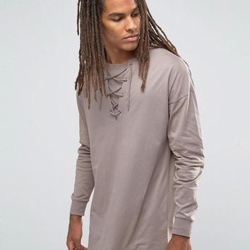 ASOS | ASOS Oversized Long Sleeve T-Shirt With Lace-Up Collar at ASOS