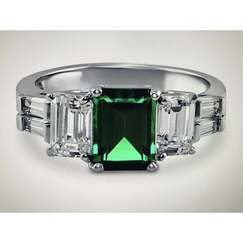 A Perfect 2.3CT Emerald Cut Emerald & Step Cut Trapezoid Engagement Ring