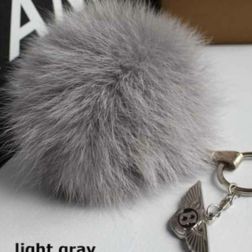 Light Grey Fox Fur Pom Pom luxury bag pendant with leather strap metal buckle key ring chain bag charm