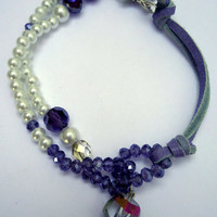 Beaded and leather bracelet with faux  pearls, purple crystals and silver plated toggle in leaf pattern