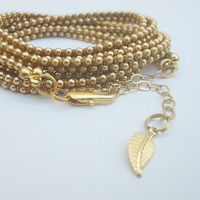Brown cotton wax cord and a gold plated chain - 6X wrap bracelet