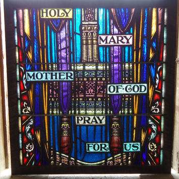 Beautiful Vintage 1930's painted stained glass church window, with the inscription Holy Mary Mother of God Pray for Us.