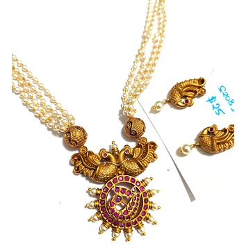 Traditional matte gold finish Kemp stone Peacock pendant with multi stranded pearl chain necklace and stud earring set