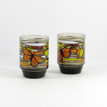 Vintage 1970s Libbey Kitschy Butterfly Glasses, with retro orange, yellow and white monarch butterfly pattern. Set of two tumblers.