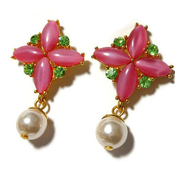 Pink cross earrings, pink glass navettes in the shape of a cross, with green rhinestones and a dangling white glass pearl, pierced post drop