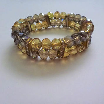 vintage ChaCha glass bead bracelet. amber bead bracelet. elastic bracelet. faceted glass bead bracelet