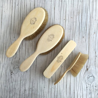 A collection of dressing table monogrammed brushes. 4 antique Victorian ladies bristle brushes. Circa late 1800s.