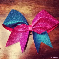 Turquoise and pink glitter cheer bow.