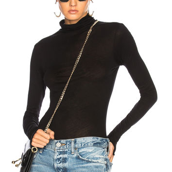 Enza Costa Fitted Turtleneck Top in Black | FWRD