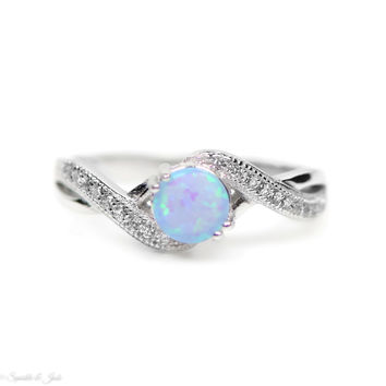 Sterling Silver Medium Blue Opal and Crossed Band CZ Ring