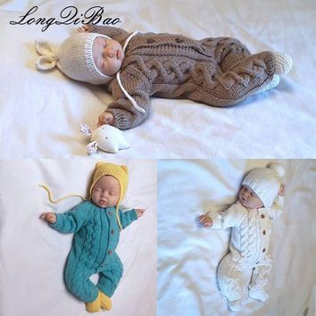 Hand knitted long-sleeved knit baby sweater with matching hat