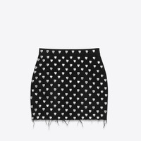 SAINT LAURENT 80'S HEART STUDDED MINI SKIRT IN RINSE BLACK DENIM AND SILVER TONED METAL | YSL.COM
