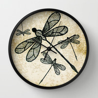 Dragonflies on tan texture Wall Clock by Wendy Townrow