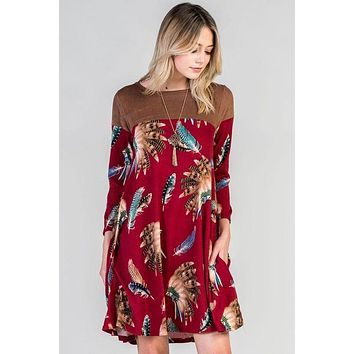 Bellamie burgundy feather swing dress with suede contrast.