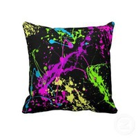 Colorful Neon Paint Splatters on Black Pillow from Zazzle.com