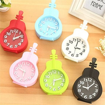 Plastic Desktop Clock Stereo Guitar Alarm Clock Student Cartoon Small Home Decoration Stand = 1715216964