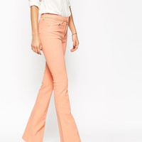 ASOS Bell Flare Jeans In Pink with Raw Hem