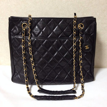 Vintage CHANEL black quilted lambskin classic tote bag with gold tone chains and CC charm. Classic purse.