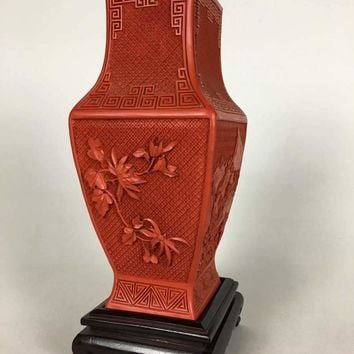 Cinnabar quadrangular vase with carved wooden base