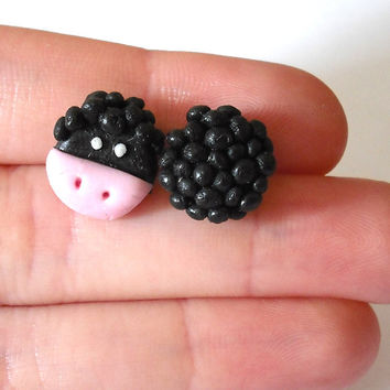 Black sheep stud earrings modeled by hand in cold porcelain