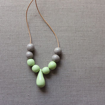 Handmade mint green ceramic beads - mint green and gray strand necklace - beadwork on thin leather cord