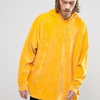 ASOS Extreme Oversized Hoodie in Yellow Velour at asos.com
