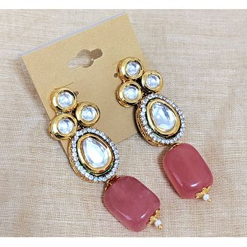Oval center Kundan stone surrounded by white rhinestone with natural bead Earring