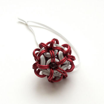 Red and white chainmaille dodecahedron Christmas ornament