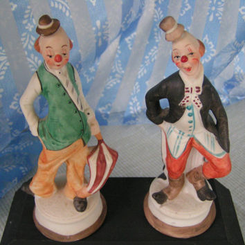 Pair of Vintage Porcelain Skinny Clowns, joyful and funny, one in green vest another in long black coat
